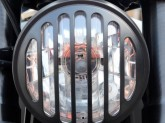 Headlight with non-removable grille